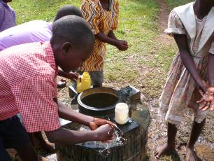 school children washing hands