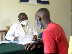 Nursing officer seeing a patient