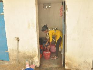 Woman from Odisha washing clothes