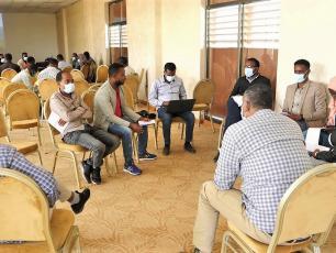 Workshop participants discussing master plans