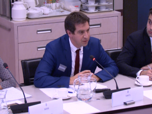 IRC's Stef Smits presents his case to Dutch Members of Parliament, flanked by Rolien Sasse and Giacomo Galli