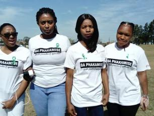 Girls wearing t-shirts of local NGO Ba Phakamise