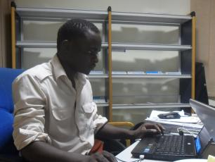 Young professional from Uganda at work in Ghana