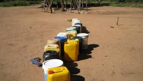 line of water carriers at a water point