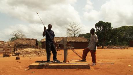 Maintenance on a water pump in Ghana