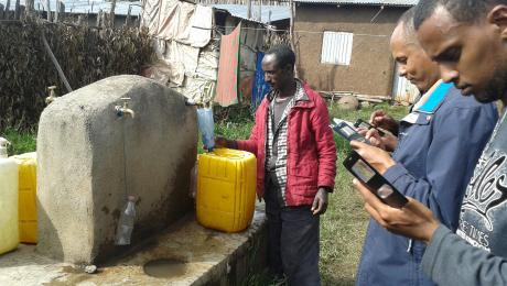 Collecting WASH baseline data with mobile phones at standpipe in Ethiopia