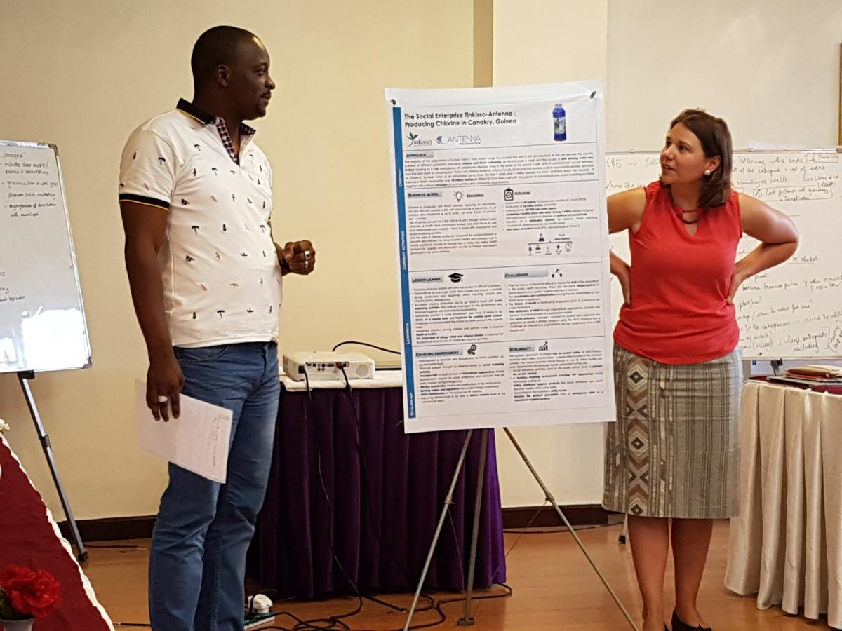 Aboubacar Camara (on the left) presenting during a workshop with Fanny Boulloud (on the right)