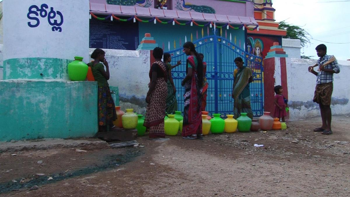 End users at water point in India