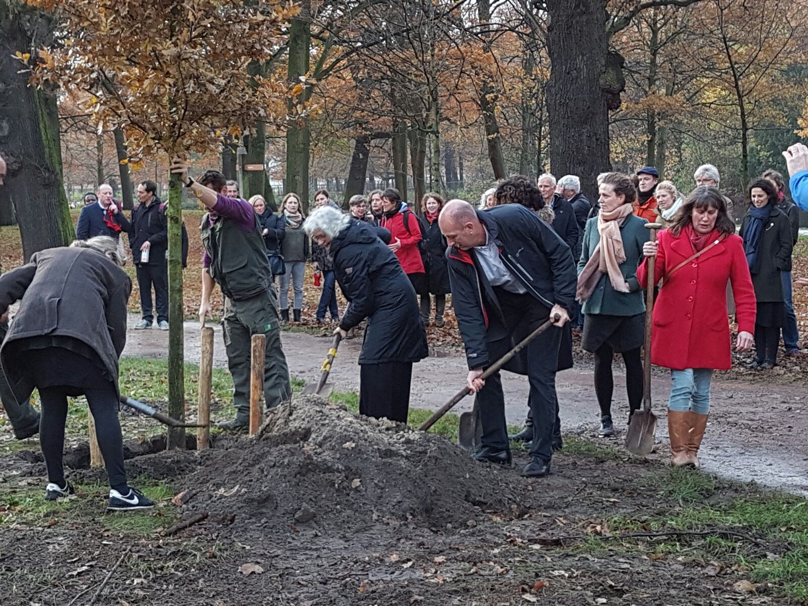 Family, friends and IRC staf planting a tree in memory of Ton Schouten