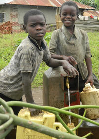 Satisfied users: children fetch water at a tap in Kichwamba sub county, Kabarole District